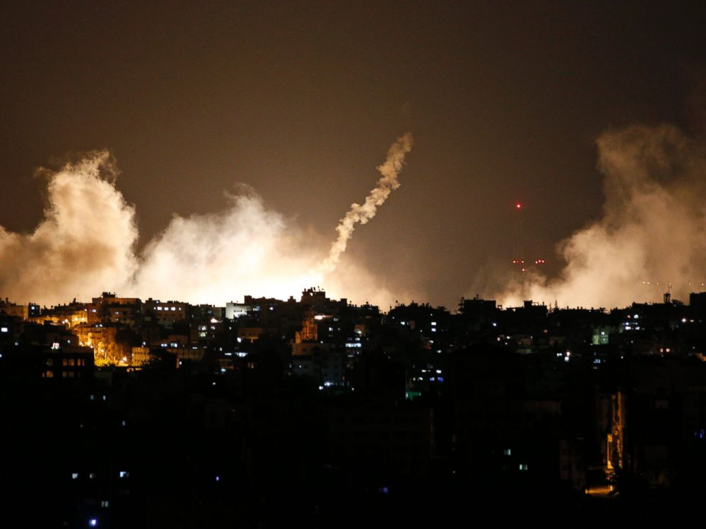 PHOTO: Smoke from flares rises in the sky in Gaza City, in the northern Gaza Strip, July 17, 2014.