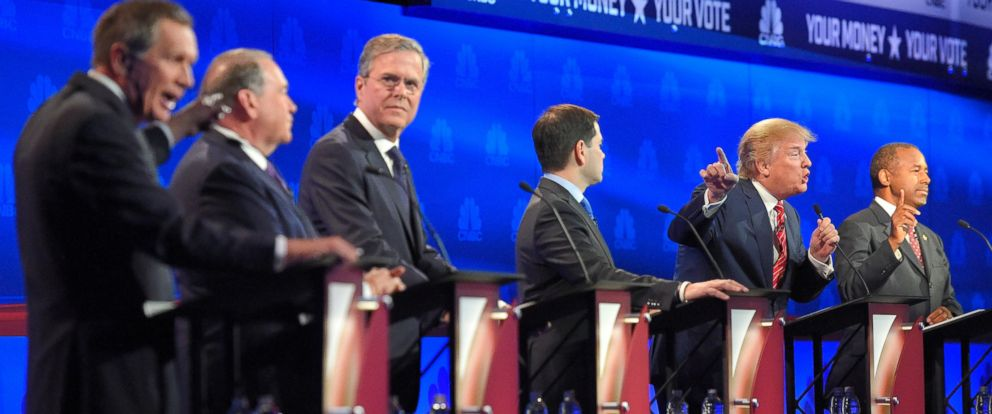 PHOTO: John Kasich, left, and Donald Trump, second from right, argue across fellow candidates during the CNBC Republican presidential debate at the University of Colorado, Wednesday, Oct. 28, 2015, in Boulder, Colo.