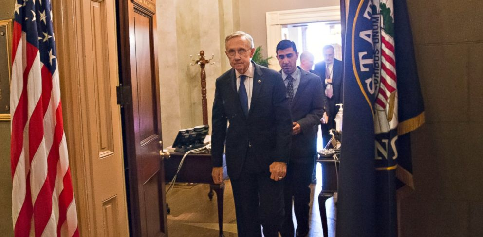 PHOTO: Senate Majority Leader Harry Reid, D-Nev., leaves the Capitol office of his Republican counterpart