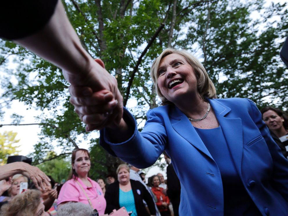 PHOTO: Democratic presidential candidate Hillary Rodham Clinton shakes hands with guests during a house party, July 16, 2015, in Windham, N.H.