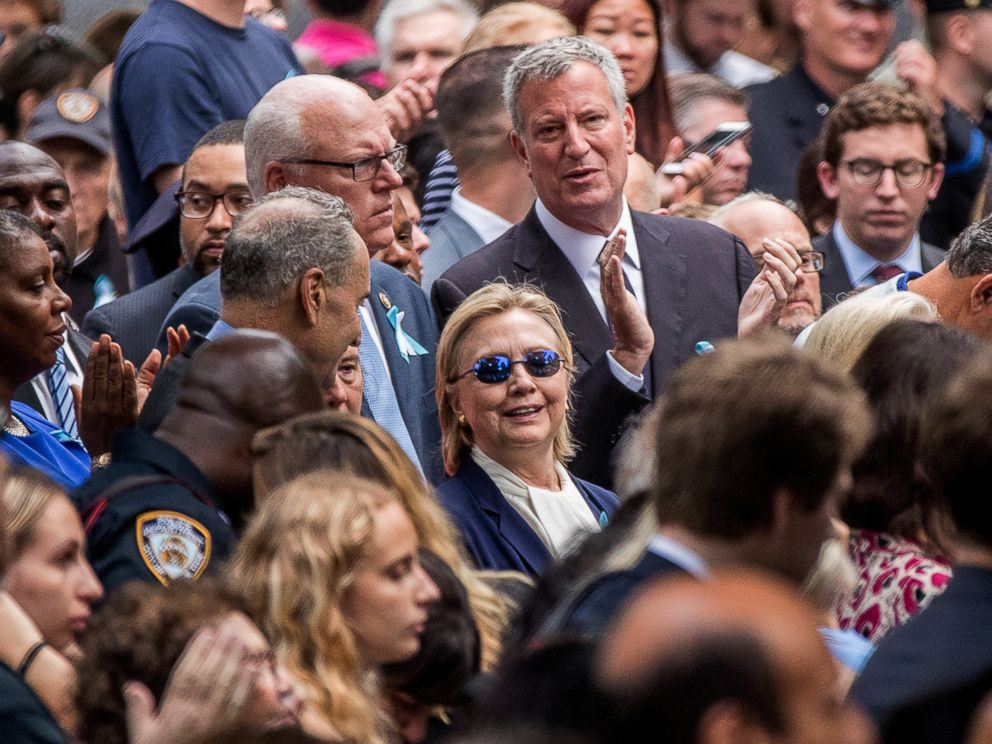PHOTO: Democratic presidential nominee Hillary Clinton, center, accompanied by Sen. Chuck Schumer, center left, and New York Mayor Bill de Blasio, center top, attends a ceremony at the Sept. 11 memorial, in New York, Sept. 11, 2016.