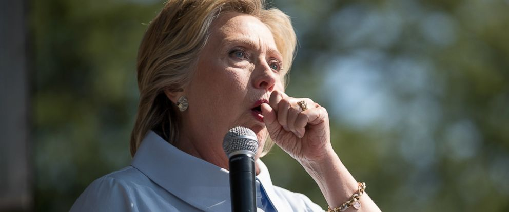 PHOTO: Democratic presidential nominee Hillary Clinton stops her speech to cough at the 11th Congressional District Labor Day festival at Luke Easter Park in Cleveland, Sept. 5, 2016.