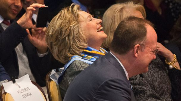 PHOTO: Former Secretary of State Hillary Rodham Clinton laughs as she attends a speech by her husband, former President Bill Clinton, April 30, 2014, at Georgetown University in Washington.