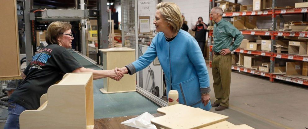 PHOTO: Democratic presidential candidate Hillary Rodham Clinton shakes hands with Amy Alexander during a factory tour at Whitney Brothers Inc., April 20, 2015, in Keene, N.H.