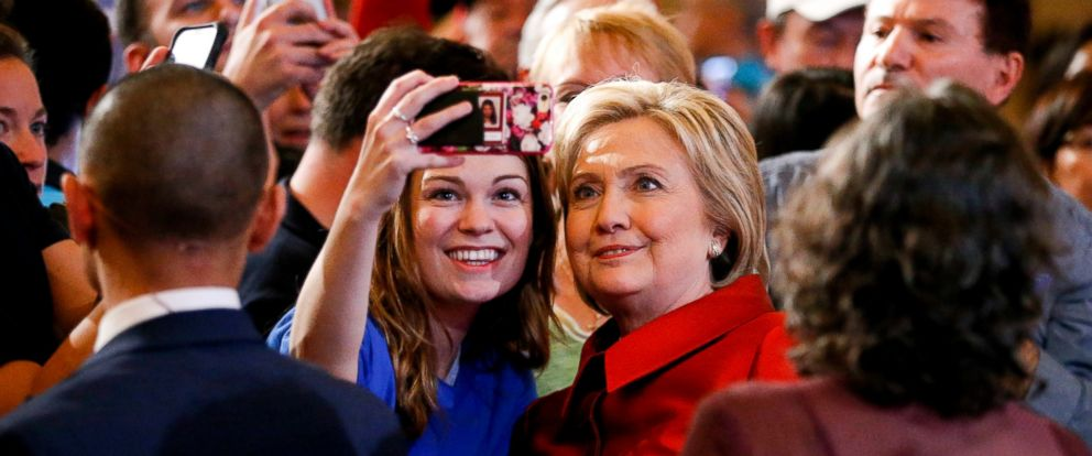 PHOTO: Democratic presidential candidate Hillary Clinton stands with a supporter taking a selfie photograph at a Nevada Democratic caucus rally, Feb. 20, 2016, in Las Vegas.