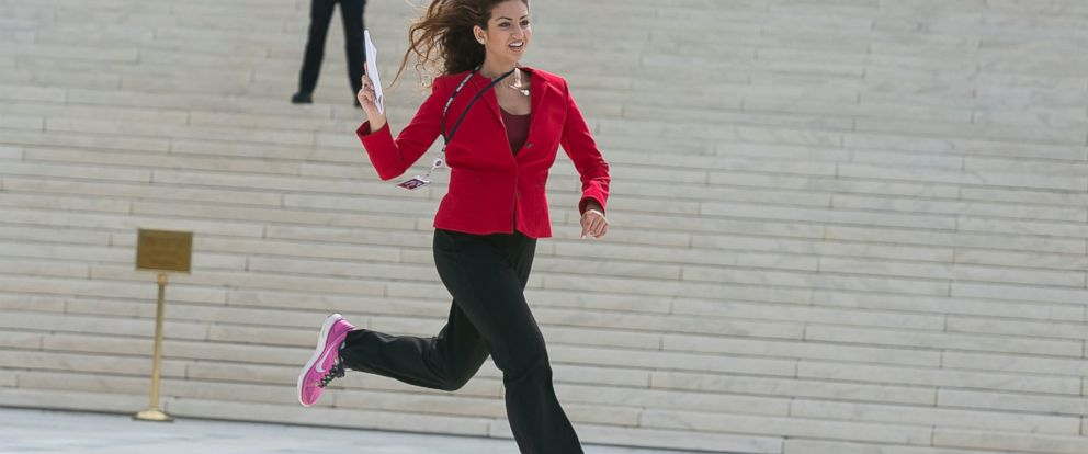 "PHOTO: Members of the news media, including interns for network television stations, run with decisions in hand on the opinion for health care, June 25, 2015, in an official tradition referred to as the ""running of the interns in Washington."