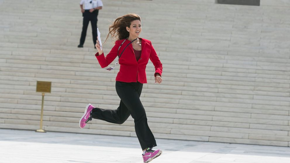 "Members of the news media, including interns for network television stations, run with decisions in hand on the opinion for health care, June 25, 2015, in an official tradition referred to as the ""running of the interns in Washington."