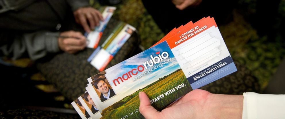 PHOTO: A supporter, left, fills out a form committing to caucus for Republican presidential candidate Sen. Marco Rubio, R-Fla., given to him by a volunteer after a campaign event in Cedar Rapids, Iowa, Jan. 24, 2016.