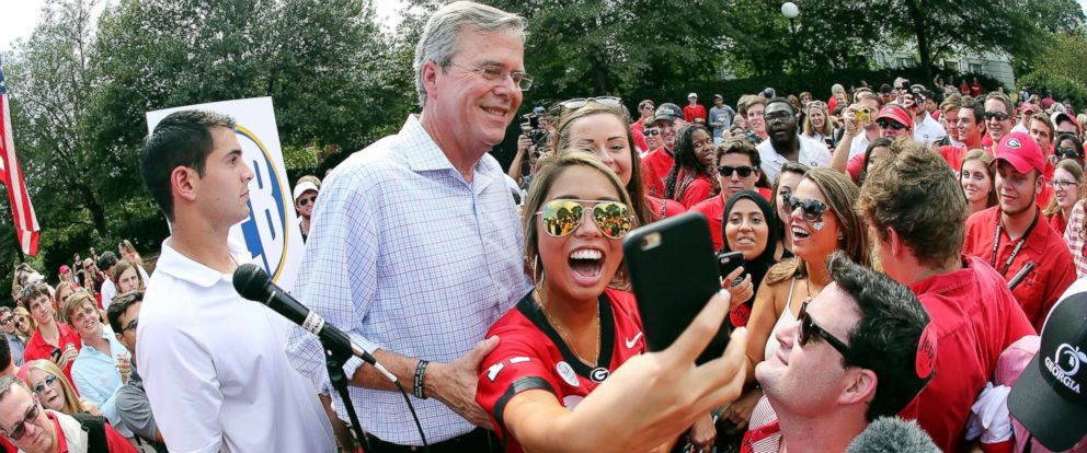 PHOTO: Republican presidential candidate and former Florida Gov. Jeb Bush poses for a photograph with Katie Wong during a tailgate party before an NCAA college football game between Georgia and South Carolina, Sept. 19, 2015, in Athens, Ga.
