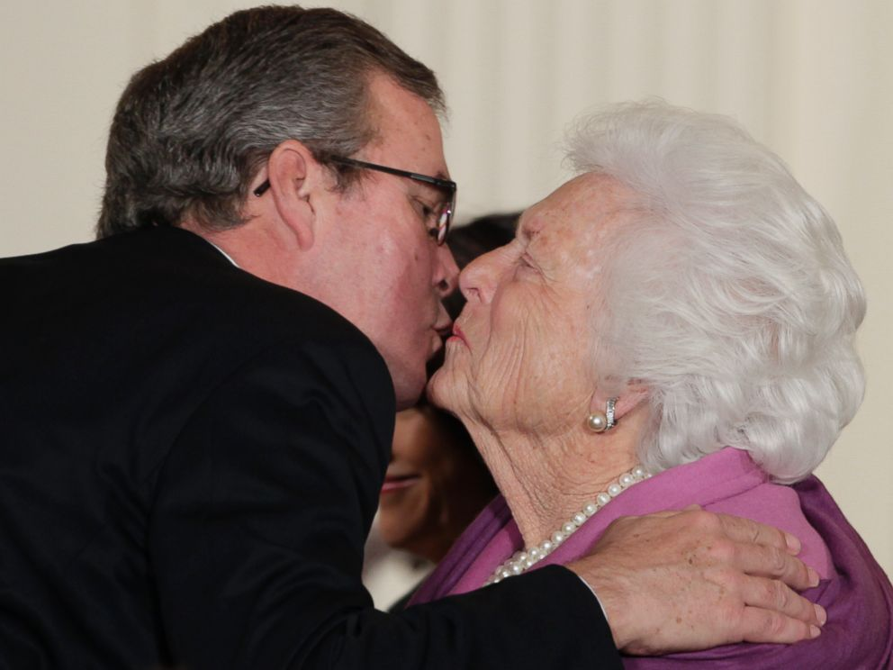PHOTO: Former first lady Barbara Bush, right, greets her son former Fla. Gov. Jeb Bush, with a kiss as she arrives at the 2010 Presidential Medal of Freedom ceremony, in this Feb. 15, 2011, file photo.