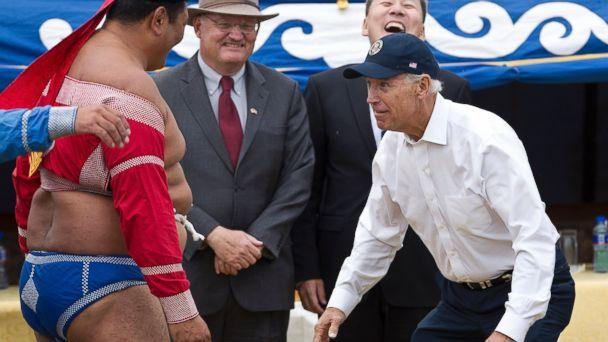 PHOTO: U.S. Vice President Joe Biden, right, meets Mongolian wrestler during Mini Nadam or Mongolian wrestling performance in Ulan Bator, Mongolia, Aug. 22, 2011.