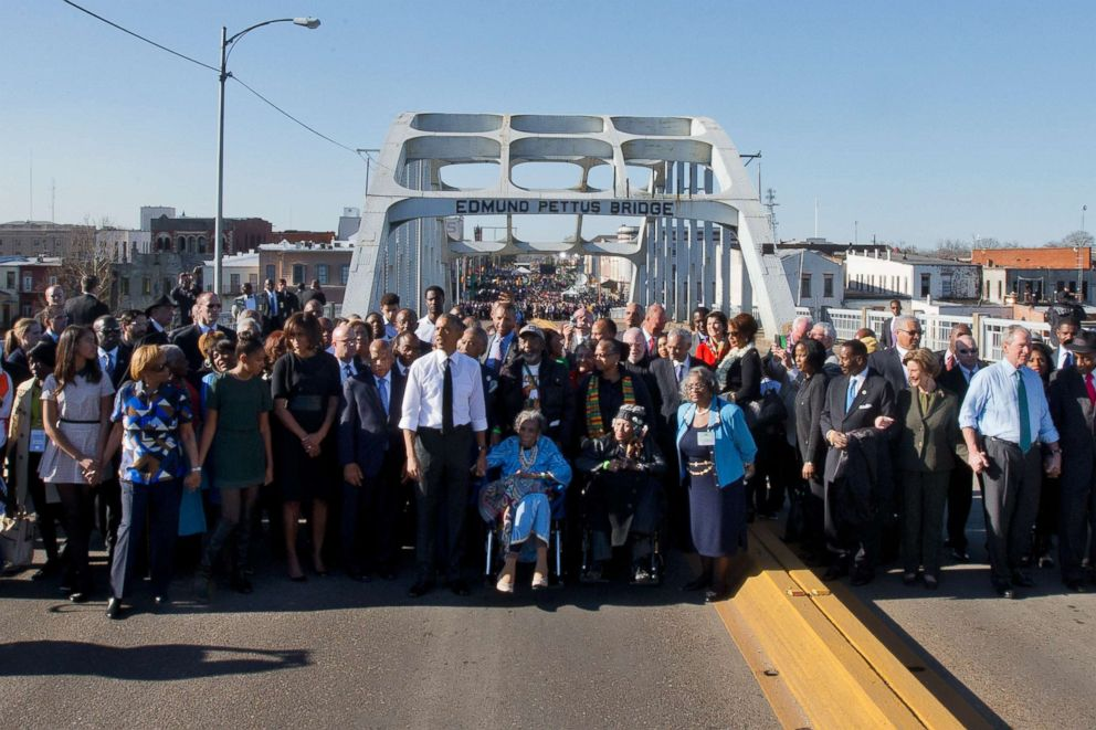 President Barack Obama, first lady Michelle Obama, Malia and Sasha as well as members of Congress and civil rights leaders make a symbolic walk across the Edmund Pettus Bridge, March 7, 2015, in Selma, Ala.