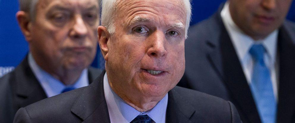 PHOTO: Sen. John McCain, R-Ariz., center, speaks during a news conference in Kiev, Ukraine, March 15, 2014.