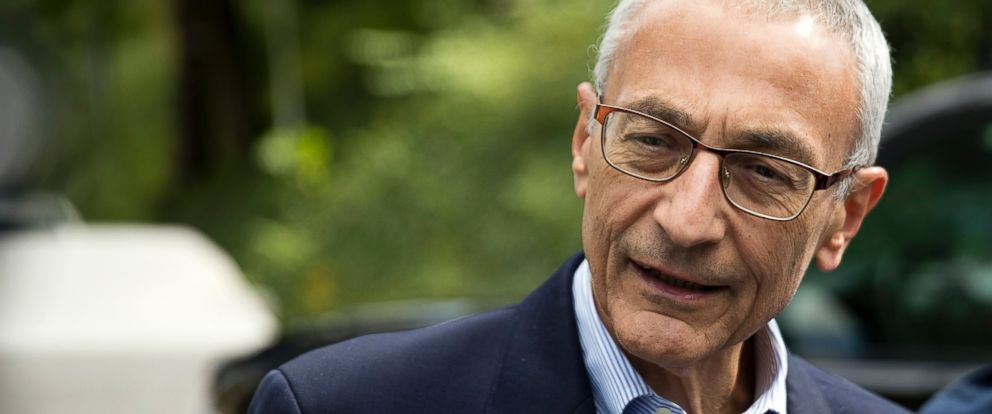 PHOTO: John Podesta speaks to members of the media outside Clintons home in Washington.