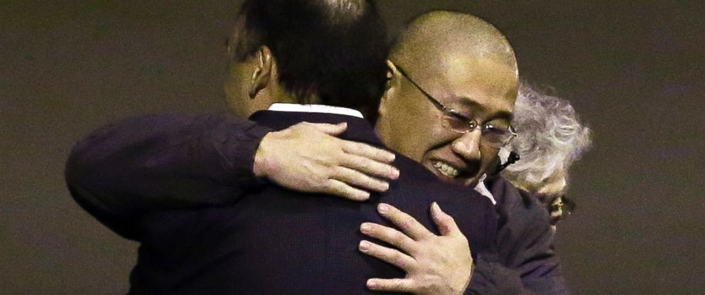 PHOTO: Kenneth Bae, center, who had been held in North Korea since 2012, is hugged after arriving, Nov. 8, 2014, at Joint Base Lewis-McChord, Wash.