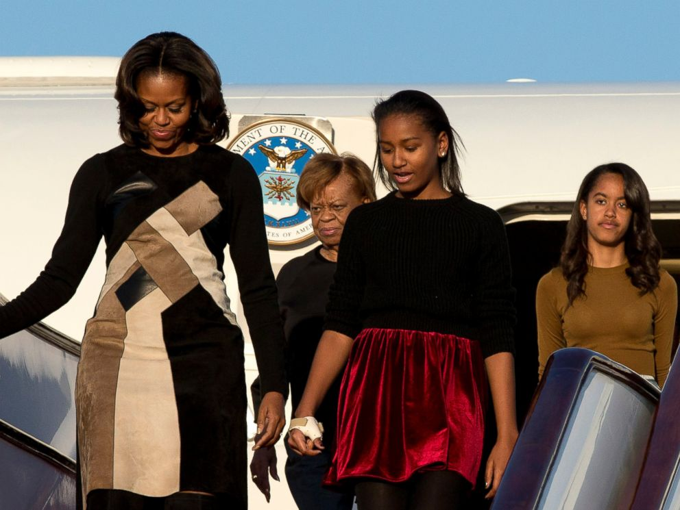 PHOTO: U.S. First Lady Michelle Obama, front left, her daughters Sasha, front right, Malia, right in the back, and Michelle Obamas mother Marian Robinson, left in the back, arrive at Capital International Airport in Beijing, March 20, 2014.