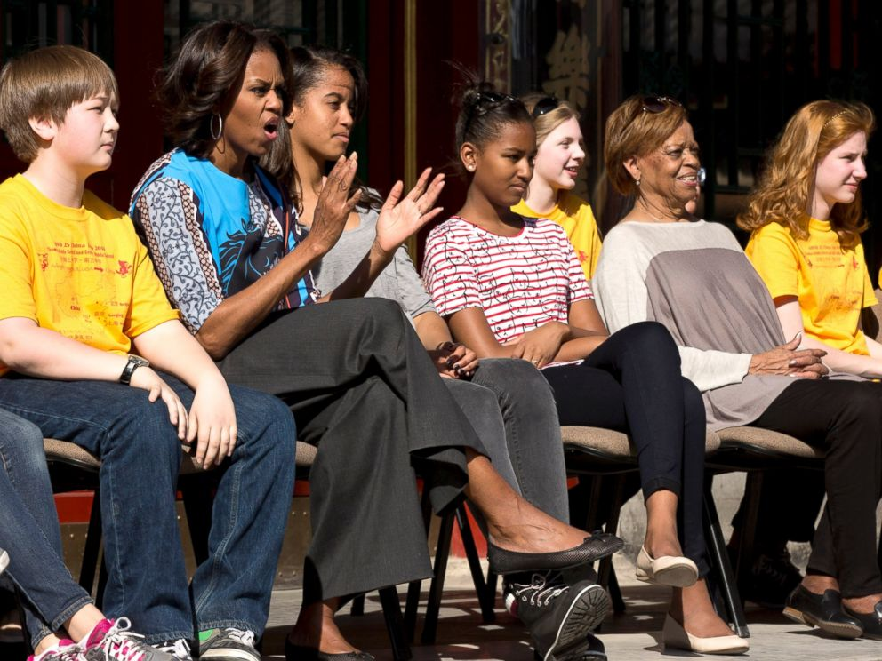 PHOTO: U.S. first lady Michelle Obama applauds as she and her daughters and mother watch a Peking opera performance with a group of American schoolchildren who are visiting China during their spring break, at the Summer Palace in Beijing, March 22, 2014.