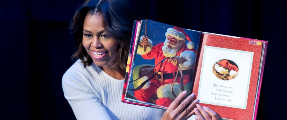 """PHOTO: First lady Michelle Obama reads """"Twas the night before Christmas""""? to patients, families, and staff at Childrens National Health System in Washington, Dec. 15, 2014."""