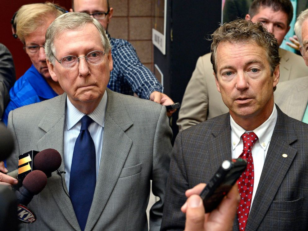 PHOTO: Kentucky Sens. Mitch McConnell, left, and Rand Paul speak with reporters