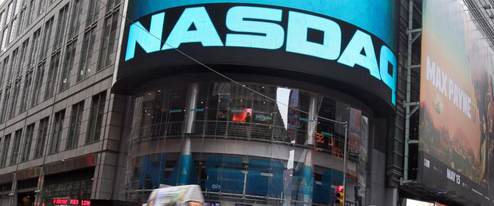 PHOTO: A taxi passes in front of the Nasdaq MarketSite in New Yorks Times Square, May 16, 2012.