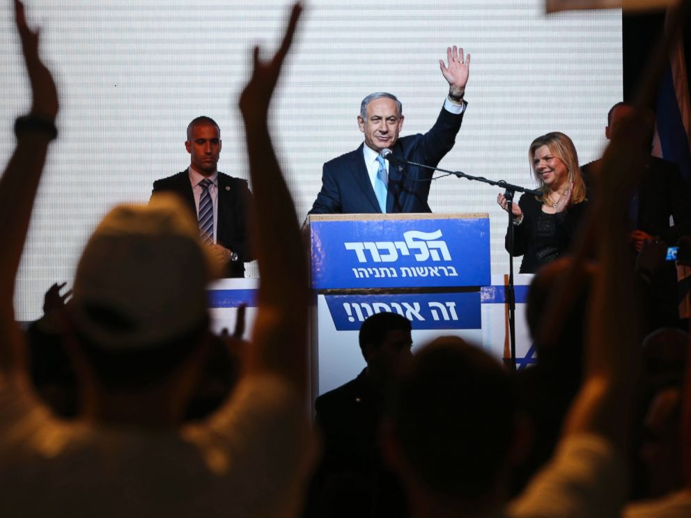 PHOTO: Israeli Prime Minister Benjamin Netanyahu greets supporters at the partys election headquarters