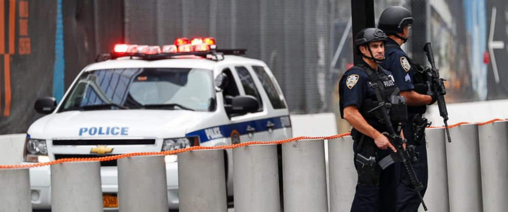 PHOTO: Heavily armed police officers stand guard at the National September 11 Memorial, Sept. 18, 2016, in New York.