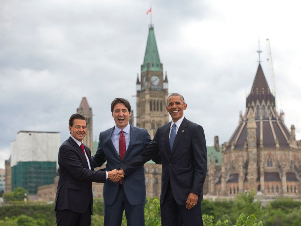 PHOTO: (L-R) Mexican President Enrique Pena Neito Mexican President Enrique Pena Neito and President Barack Obama stand in front of Parliament Hill for a group photo during the North America Leaders Summit, June 29, 2016, in Ottawa, Canada.