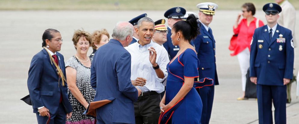 PHOTO: Rep. Bill Keating, D-Mass, left, gives President Barack Obama a golf ball as he greets the him and the first lady Michelle Obama, right, at the Cape Cod Coast Guard Station in Bourne, Massachusetts, Aug. 6, 2016, en route to Marthas Vineyard.