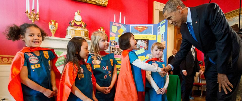 PHOTO: Dressed in super hero capes, six-year-old Girl Scouts meet with President Barack Obama before showing him their project during his tour of the White House Science Fair, March 23, 2015.