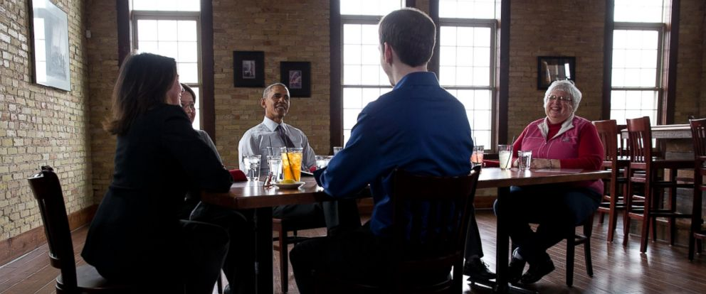 PHOTO: President Barack Obama has lunch with ACA letter writers at Engine Company No 3 in Milwaukee, March 3, 2016. Joining the president are Brent Brown, Karen George, Karen and Sharon Szyszko and Susan Campbell.