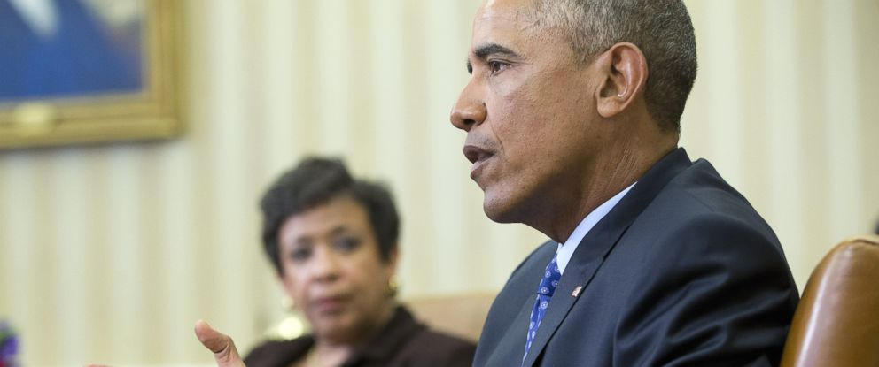 PHOTO: Attorney General Loretta Lynch listens as President Barack Obama speaks in the Oval Office of the White House in Washington, Jan. 4, 2016.