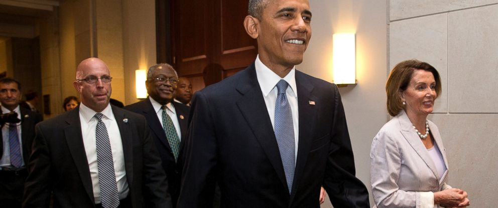 PHOTO: President Barack Obama walks with House Minority Leader Nancy Pelosi of Calif., right and House Minority Assistant Leader James Clyburn of S.C., as he visits Capitol Hill in Washington, June 12, 2015, for a meeting with House Democrats.