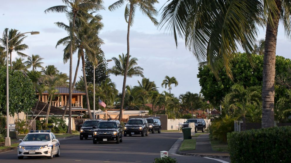 The motorcade carrying President Obama drives to the gym on Dec. 31, 2014, from his rental home in Kailua, Hawaii, during the Obama family vacation.