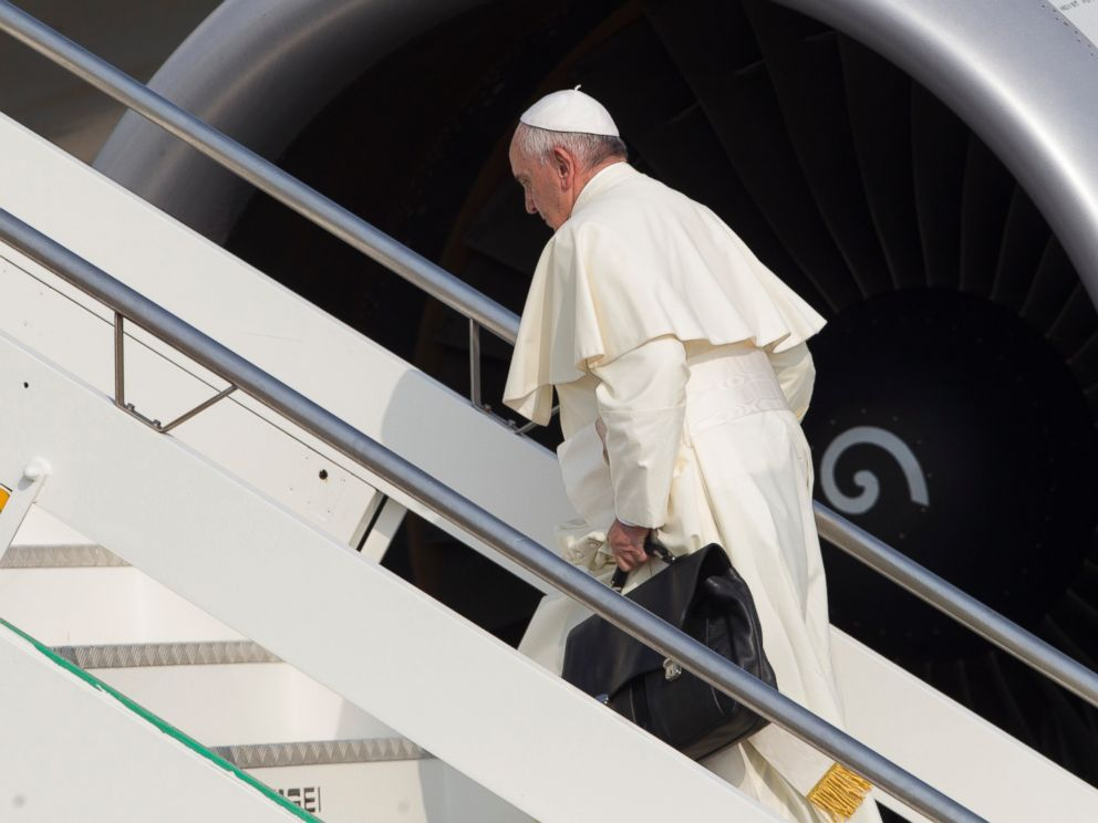 PHOTO:Pope Francis carries his work bag in Romes Fiumicino International airport, July 5, 2015, as he boards his flight to Quito, Ecuador.