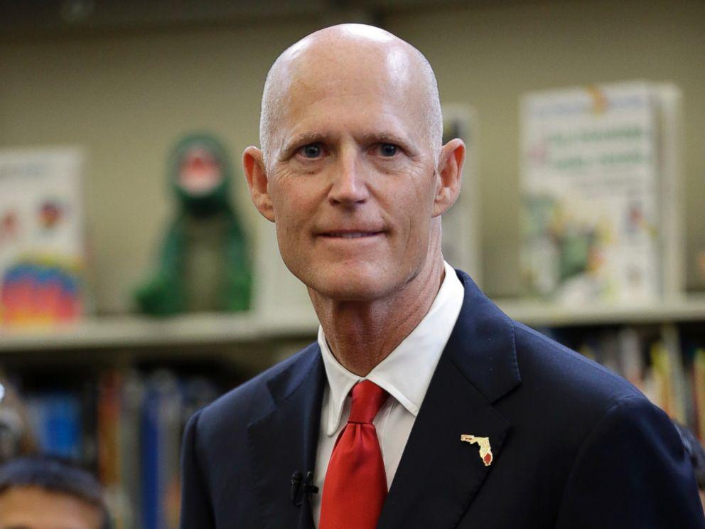 PHOTO: Florida Gov. Rick Scott waits to speak at the Dr. Carlos J. Finlay elementary school, June 1, 2015, in Miami.