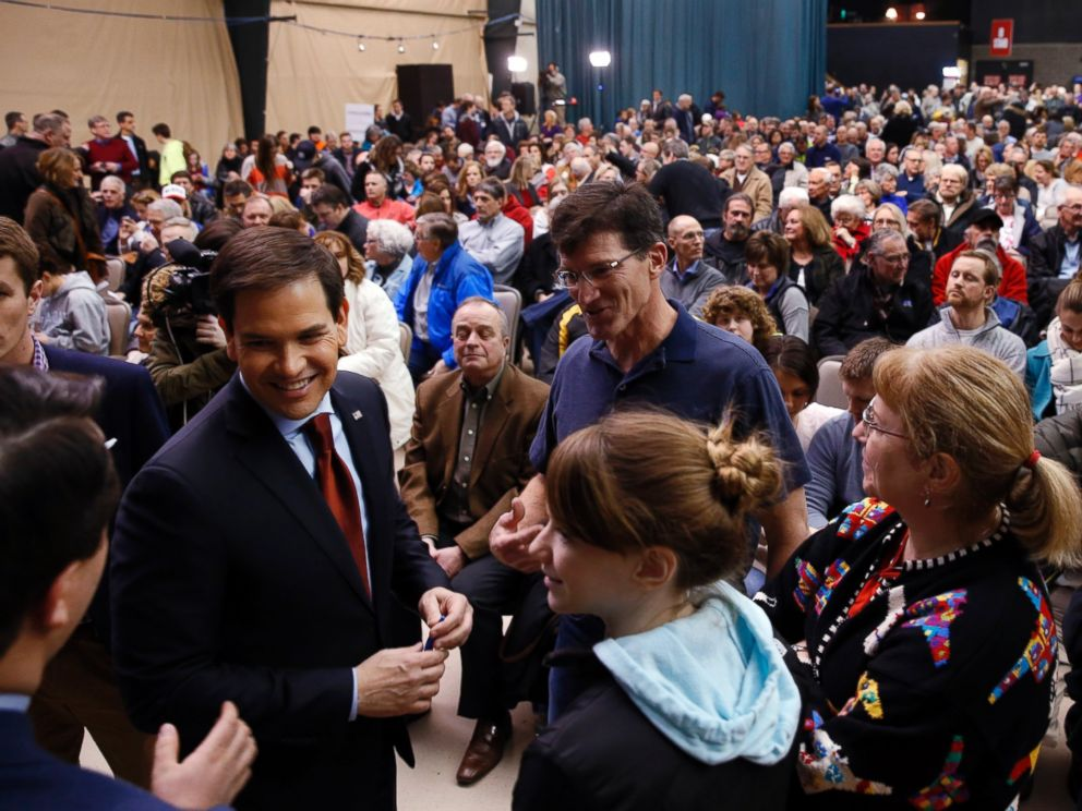 PHOTO: Republican presidential candidate Sen. Marco Rubio, talks with voters at a caucus site, Feb. 1, 2016 in Clive, Iowa.