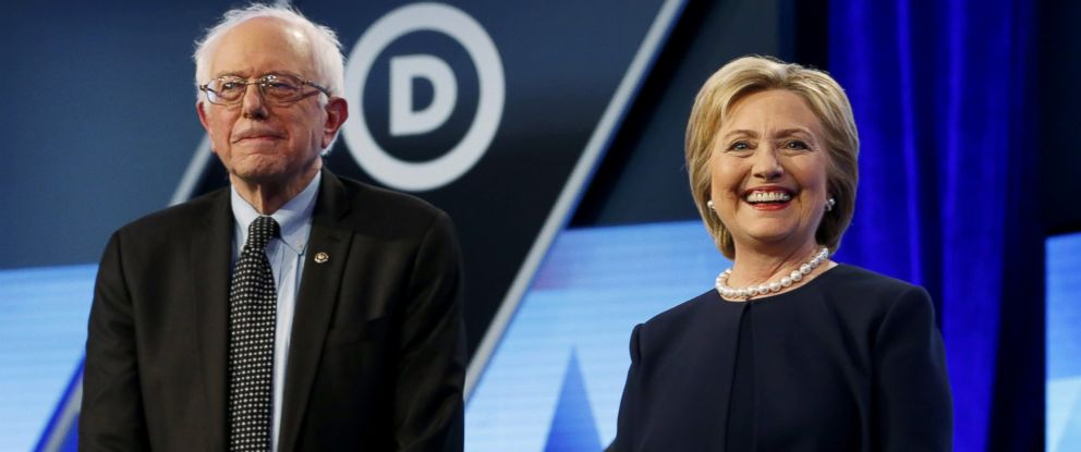 PHOTO: Democratic presidential candidates, Hillary Clinton and Sen. Bernie Sanders, I-Vt, stand together before the start of the Univision, Washington Post Democratic presidential debate at Miami-Dade College, March 9, 2016, in Miami.