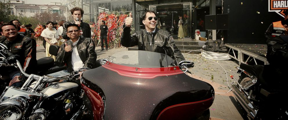 PHOTO: Wisconsin Governor Scott Walker, center, shows a thumb-up on a Harley-Davidson motorcycle during the opening ceremony of the Harley-Davidson dealership in Tianjin, China, April 16, 2013.