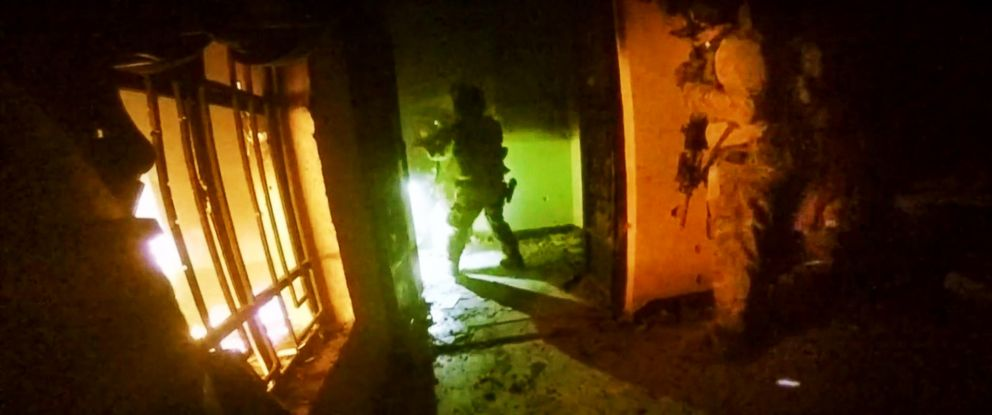 PHOTO: A helmet camera, shows U.S. and Iraqi special forces freeing hostages from a prison controlled by Islamic State militants,Oct. 22, 2015.