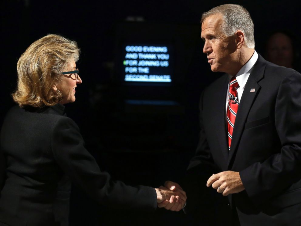 PHOTO: Sen. Kay Hagan, left, D-N.C., and North Carolina Republican Senate candidate Thom Tillis, right, greet prior to a live televised debate in Research Triangle Park, N.C. on Oct. 7, 2014.