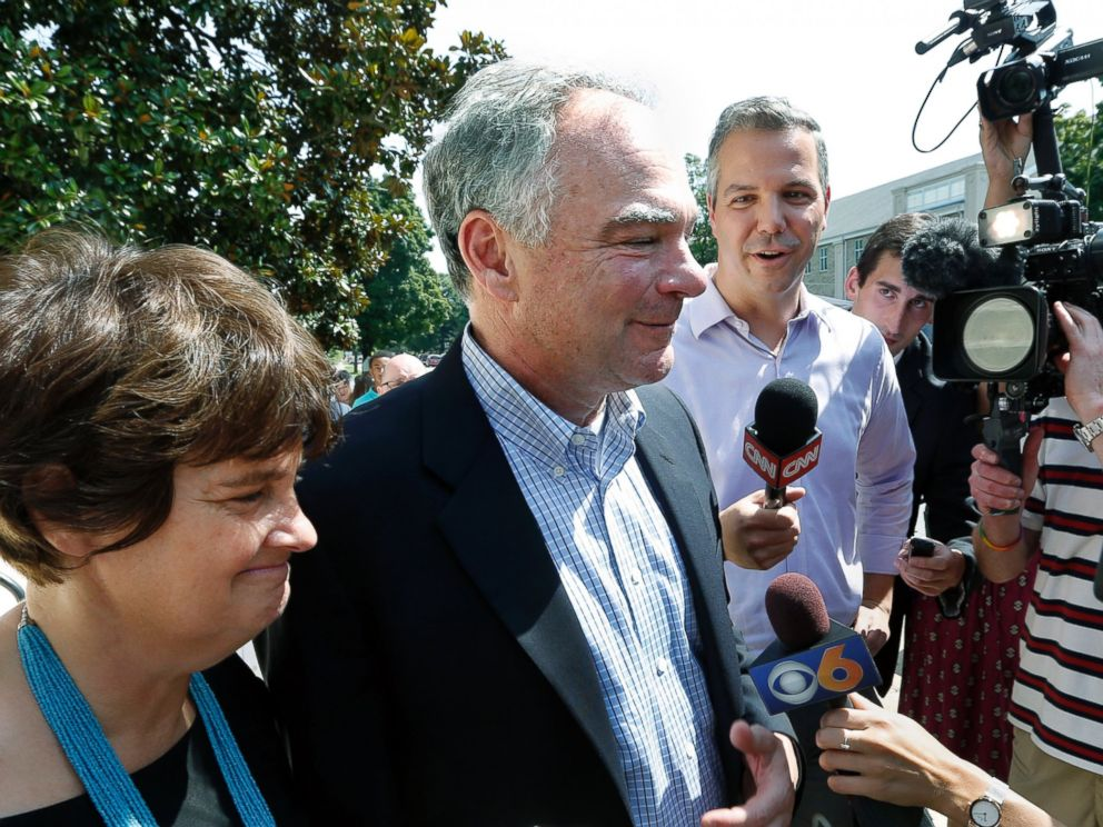 PHOTO: Senator Tim Kaine, center, with his wife Anne Holton, answers questions after attending Mass at their church, St. Elizabeth Catholic Church, in Richmond, Va., July 24, 2016.