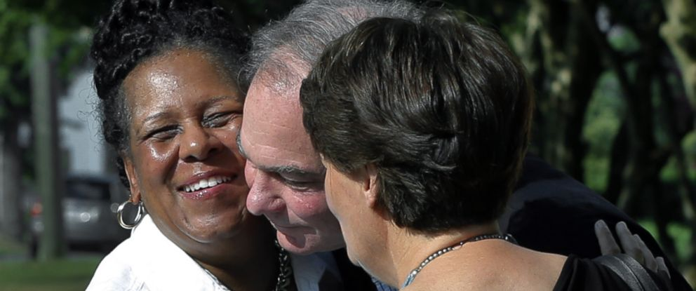 PHOTO: A fellow parishoner, left of St. Elizabeths Catholic Church in Richmond, Va. greets Sen. Tim Kaine, center, and his wife, Anne Holton as they arrive for Mass St. Elizabeth Catholic Church, their longtime parish, July 24, 2016.