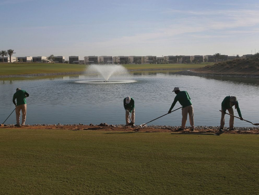 PHOTO: Gardeners put the final touches on greens at the Trump International Golf Club, in Dubai, United Arab Emirates, Dec. 20, 2016.