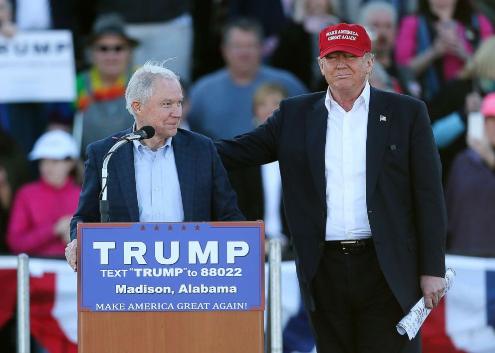 Donald Trump right stands next to Sen. Jeff Sessions as Sessions speaks during a rally on Feb. 28 2016 in Madison Ala
