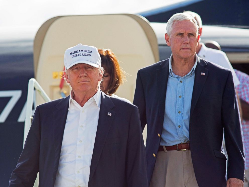 PHOTO: Republican presidential candidate Donald Trump, followed by his running mate, Indiana Gov. Mike Pence, emerges from his plane as he arrives to tour the flood damaged city of Baton Rouge, La., Aug. 19, 2016.