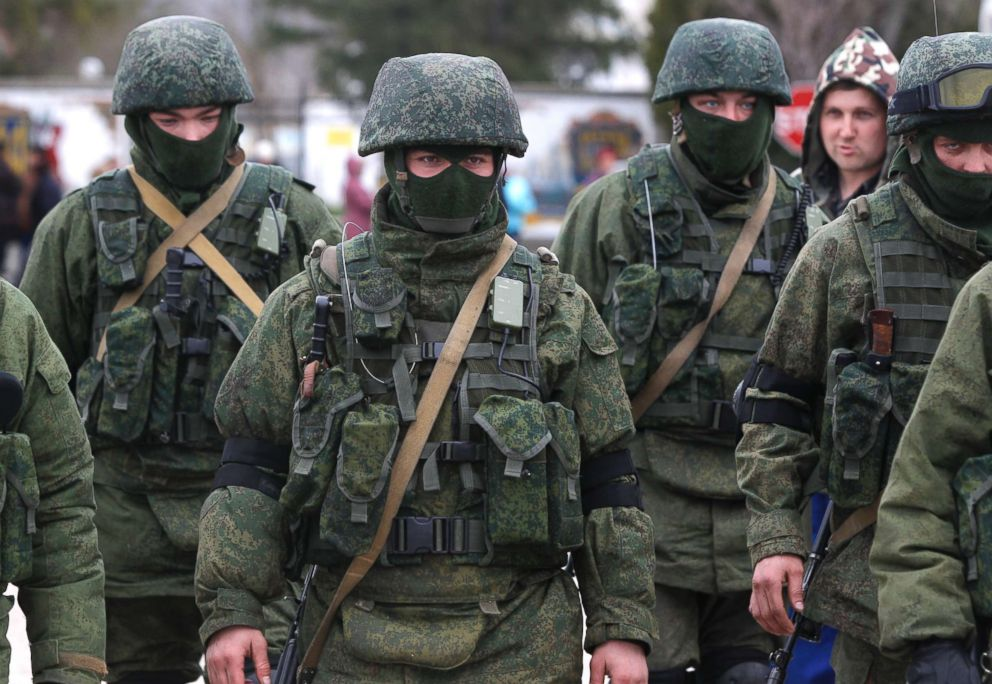 PHOTO: Pro Russian soldiers guard Ukraines infantry base in Perevalne, Ukraine, March 4, 2014. Russian President Vladimir Putin said Moscow reserves the right to use all means to protect Russians in Ukraine as U.S.Perevalne, Ukraine, March 4, 2014.