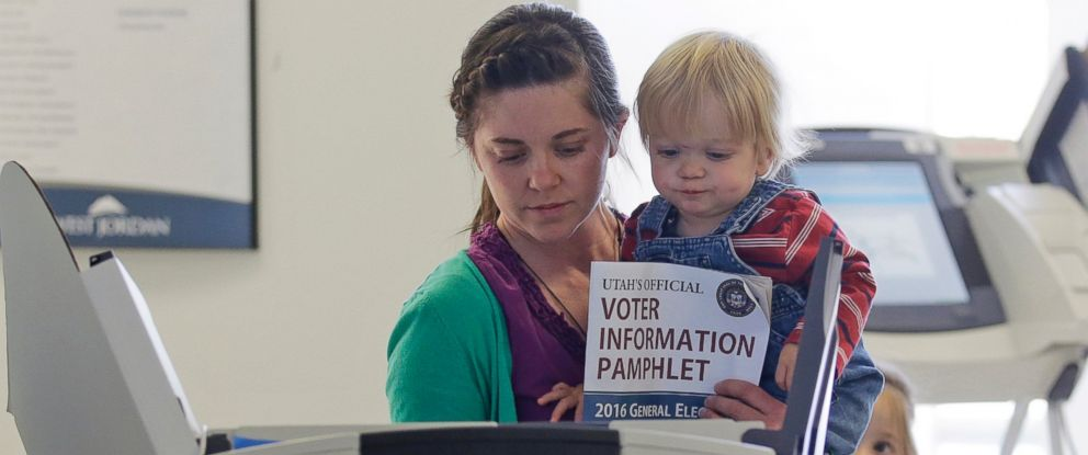 PHOTO: Jill Tobler votes as she holds her 16-month-old son Joey, while her daughter Tessa, 5, watches during early voting for the 2016 general election at the West Jordan city hall, Nov. 3, 2016, in West Jordan, Utah.