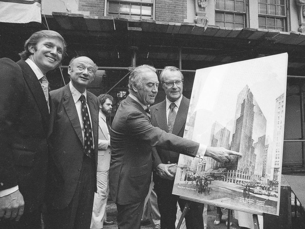 driving  street PHOTO: Governor Hugh Carey points to an artists conception of the new New York Hyatt Hotel/Convention facility that will be build on the site of the former Commordore Hotel, June 28, 1978.