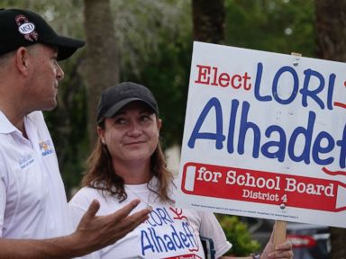 PHOTO: Lori Alhadeff speaks with County Commissioner Michael Udine at a polling place in Tamarac, Fla., Aug. 28, 2018.