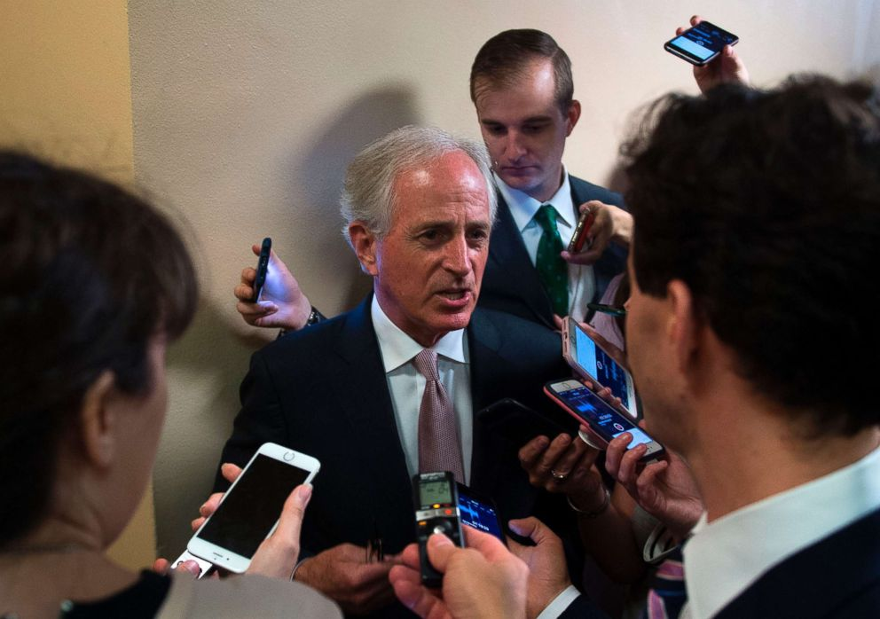 PHOTO: Senator Bob Corker (R-TN) is surrounded by reporters as they ask him questions regarding the Trump-Putin meeting on July 17, 2018 on Capitol Hill in Washington.